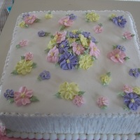 "Floral Bridal Shower  This cake was made for a bridal shower. It's a two-layer 12"" square white almond sour cream cake with vanilla buttercream. The..."