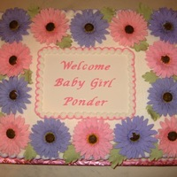 Gerber Daisy Baby Shower  I made this cake for a co-worker's baby shower. The mom-to-be loves gerber daisies.The gerber daisies are gumpaste/fondant and the...