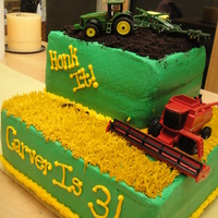 John Deere White cake, rasp filling and BC with oreos for the dirtTractor and combine are toys! My son Loved it!