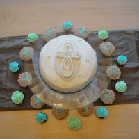 Boy Baptism Cake is marble with raspberry filling and buttercream with fondant cross. Cupcakes are pumpkin pie with pumpkin cream cheese frosting!...
