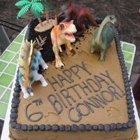 Dino Cake Chocolate cake, bevarian cream filling and white bc. Birthday boy decided he wanted 4 dinos on there instead of the 3 that I put on! So...