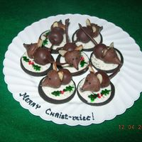 "Christmas Mice   Based on photo by ""Dale"" my first try at these mice. Hershey kiss head, chocolate covered cherry tail, almond ears. Very fun!"