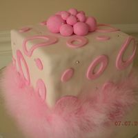 Pink Boa Cake   Square cake covered in fondant with silver dragee details. Non-edible feather boa decoration.