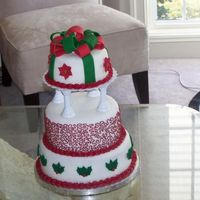 First Wedding Cake (Christmas Theme) This was a cake I made for my last Michael's cake decorating class. It's red velvet with fondant and buttercream. Thanks for...