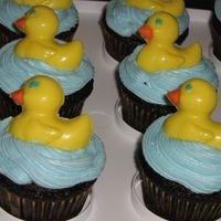 Duckie Cupcakes These cupcakes were made for a baby shower - buttercream icing, and chocolate molded duckies on top. REALLY easy!