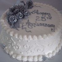 25Th Anniversary Cake WASC and buttercream cake with silver and white pearl dusted fondant roses. I made his cake for a neighbor who was driving 3 hours to...