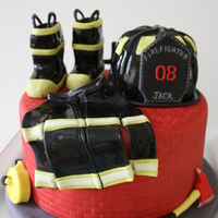 Firefighter Jacks Bday Cake My turned 8 this week and he wanted a firefighter themed cake. I decided to make a cake that had some of the things firefighters would use...