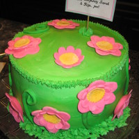 Flower Cake   Pistachio Cake with pistachio cream filling. Buttercream frosting with fondant flowers. Cake for a spring surprise birthday party!