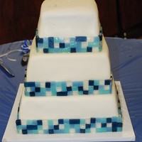 Blue Tile Mosaic Banana with strawberry filling and banana w/fudge filling, buttercream iced and MMF covered. Tiles were made of isomalt and attached with...