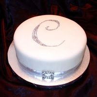 Bling Just a fun little cake to make. Sue B's chocolate cake recipe submitted by JanH and milk chocolate ganache filling. MMF with...