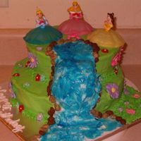 Princess Birthday Flowers are made out of fondant and royal icing. Waterfall was made from BC and blue glitter gel. TFL!