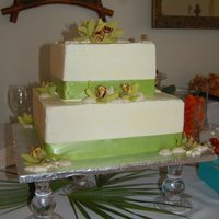 Wedding Cake   This is a yellow cake with meringue buttercream and white chocolate shells