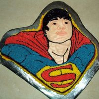 Superman Cake A woman ordered this cake from me--she bought the pan and wanted her boyfriend's face instead of Superman's.I made his face as a...