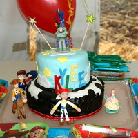 Toy Story Cake for a Toy Story girl. Figures are plastic, accents are fondant.