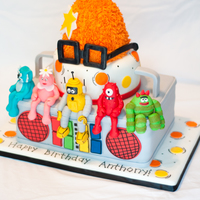 Yo Gabba Gabba I made this for my nephew's birthday. Bottom tier is the boom box with hand sculpted figures sitting on the edge. The hat is rice...