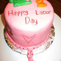 Labor Day Cake 6in white velvet butter cake, no filling, covered in pink fondant and decorated with a dragon and kitten fondant mold and food color...