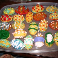 Easter Egg Cupcakes White Easter egg cakes decorated with different colored buttercream. My brother helped me.