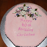 60Th Birthday Cake This is a octagonal buttercake with pink buttercream icing, the flowers are made from Flower paste.