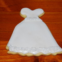 Cookies For Bridal Shower The heart and wedding cakes are a sugar cookie with fondant and the wedding dresses are sugar cookies with royal icing. These are just a...