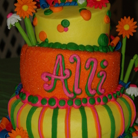 Bright 13Th Birthday Cake   3 tiered cake topped with 3D funky flowers and some hot colors to accent