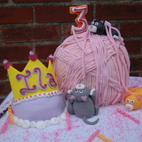 Kitty Cake Play   Large ball of cake yarn covered in fondant with kittens playing around. accented with a princess tiara for the birthday girl
