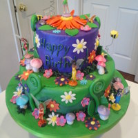 Tinkerbell Birthday This is a busy birthday cake for a 5-year-old little girl. It's vanilla with strawberry filling! Yum!