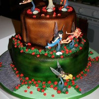 Tinkerbell And Fairies Tink and her friends on a tree stump!