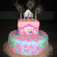 Barbie Island Princess Cake Two tiers almond cake covered in foundant. Sand is made with brown sugar.