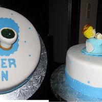 Baby Boy Baptism Cake One tier almond cake covered in foundant. Angel, baby and fountain were made in gum paste. Piping gel was added to the fountain to look...