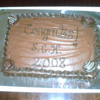 Twin Brother's Graduation Cake  Two Brothers were graduating & as a surprise gift I made this for them. Chocoholics Dream: Choc.Cake,Choc.Icing,Choc.Truffles. That&#...