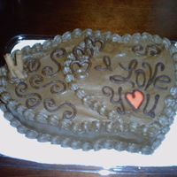 My First Valentine's Day Cake Order  Customer's wife loves Chocolate & Coffee. Words & Hearts were made with melted Semisweet Chocolate. Wafers were Cappuccino...