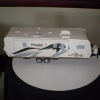 Travel Trailer Groom's Cake This is a groom's cake for a groom who is a plant manager for Forest River. The trailer actually had 2 different designs (the plant...