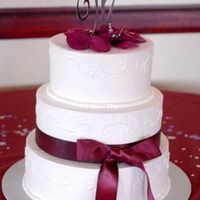Simple Wedding Cake Round Buttercream wedding cake, with satin ribbon and bow.