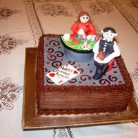 Black Jack The cake topper is all made with gumpaste, casino style cake, black jack table with dealer, cards and snacks on table, guy in front is the...