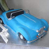 Vroom Vroom - Blue Convertable Totally vegan cake, vanilla sponge, carved into the car shape. Iced with sugar paste and accents are gumpaste and royal icing.This was such...