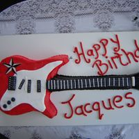 Electric Guitar - 21St Cake Rich moist chocolate cake, covered in b.c.Accents done with gum paste. this cake was just over 1 metre long.The birthday boy was very...