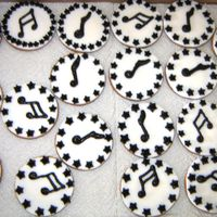 Musical Notes These are marie biscuits, covered with sugar paste, with royal icing piped music notes and borders.This too was for the 21st birthday'...