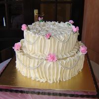 Pearls And Roses  rich moist chocolate and vanilla sponge, with white chocolate leather pleated sides, with flower paste roses, the pearls are imitation...