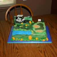 "Scott's 14Th Birthday Cake This is an 11x15 sheet cake made to look like a golf course green. The golf cart, flag, pine trees and background are from a ""Deco Pac..."