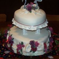 25Th Victorian Elegance Heart shaped tiers embellished with Bows, drapes & clusters of gumpaste roses
