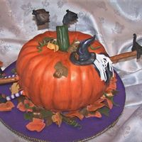 Don't Drink & Fly Double bundt cakes covered with fondant & hand shaped fondant accent pieces....Witch legs, hat with hair, broomstick, leaves,black cat...
