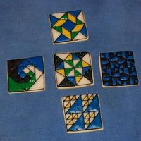 Quilt Blocks! I got a new square cookie cutter, so I decided to do some quilt blocks! NFSC with colored glace. Top: Windblown square. Middle row: Snail...