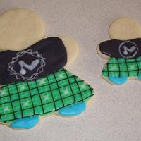 Kilted Cookies! I made a bunch of these for a raffle at a Scottich Highland games! NFSC with glace icing! The logo on the shirt is the same logo on the t-...