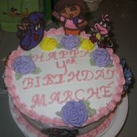Dora & Friends Similar to the first CT cake that I did. 2 layer 9 inche round cake. Figures are CTs, RI flowers, and BC icing. Thanks for looking! ;)