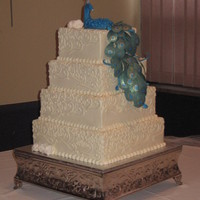 Peacock Wedding Cake This four tiered, buttercream iced wedding cake was inspired by ozcake's award winning peacock and khoudek's beautiful scroll...
