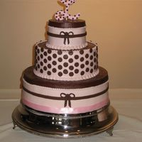 "Brown & Pinkpolka Dot Wedding This buttercream iced cake was inspired by a cake on the Knot in 2007. Polka dots and brown bows are chocolate fondant. The ""L""..."