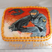 Halo Cake This cake was made for a boys birth day and Halo is his favorite game. It was covered in fondant and painted using food coloring.