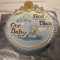 Baptismal Cake For A Baby Boy I made this cake for a baby boys baptism. The image is painted onto fondant using foodcoloring and vodka. the clouds and other decorations...