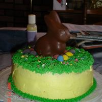 Easter_Cake_2_2.jpg My 2nd cake! Lemon cake, lemon filling and lemon BC. I used a Godiva bunny and Cadbury eggs for the decorations. I was so happy with how it...