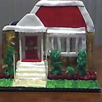 House.jpg This cake was a mini replica of a house a friend purchased...this was the first house I've done would have liked the stucture to be...